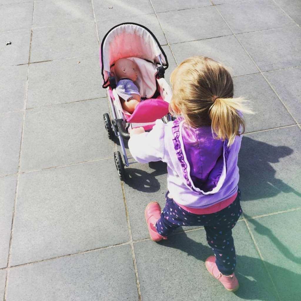 Kids pram pushed by child